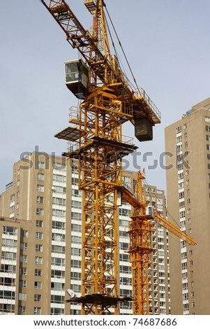 Cranes is busy at construction site, working now.