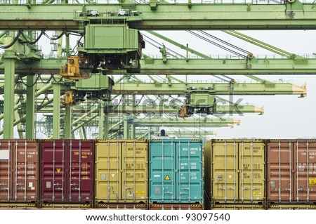 cranes loading and discharging containers in busiest port in the world - stock photo