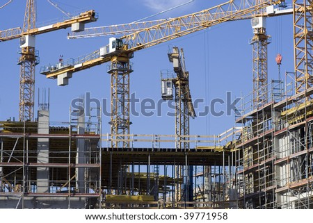 Cranes on a construction site in Berlin. - stock photo