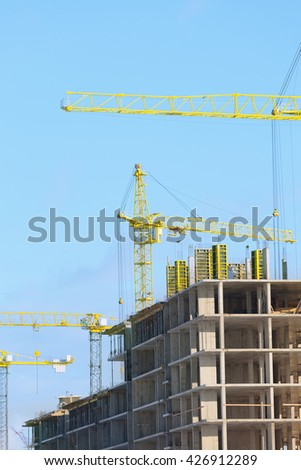 Cranes on the construction of high-rise buildings - stock photo