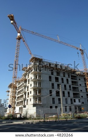 Cranes over building site