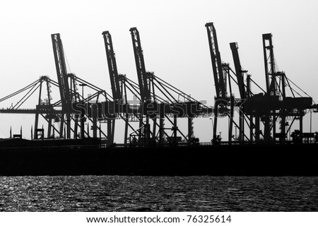 Cranes Ship Cargo silhouettes - stock photo