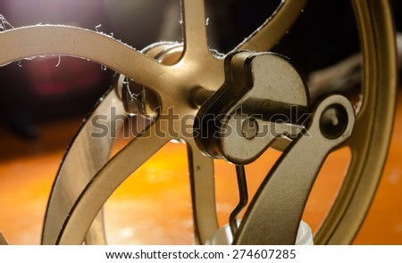 crank shafts and pulleys of machinery in bronze wheels - stock photo