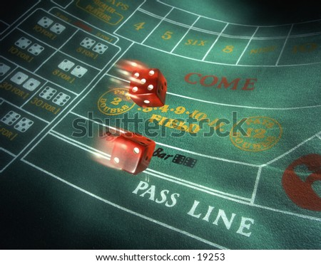 Craps special effects A pair of dice flying on a craps background showing the lucky number seven. - stock photo