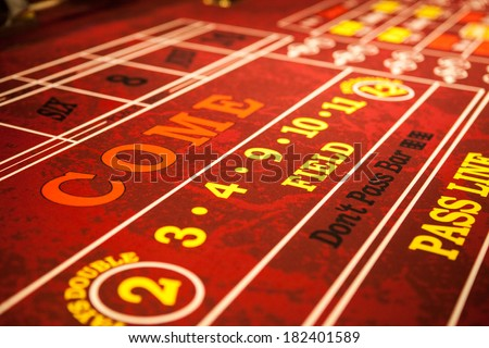 Craps table with red felt - stock photo