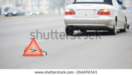 crash accident on street. damaged car automobile after collision in city - stock photo