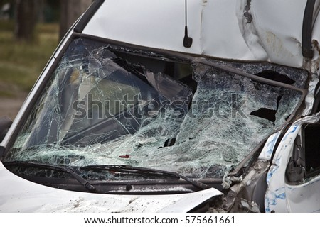 Crash car on accident site. Windshield glass