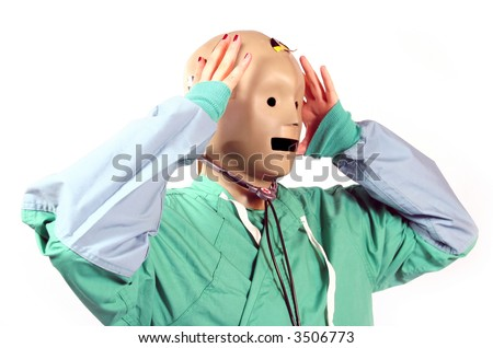 crash test dummy head on a medical worker in shock and frustration of fear - stock photo