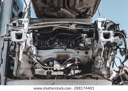 Crashed car in dismantling yard. - stock photo