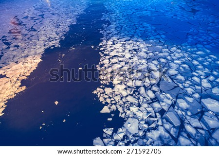 Crashed ice on the river surface. Abstract background - stock photo