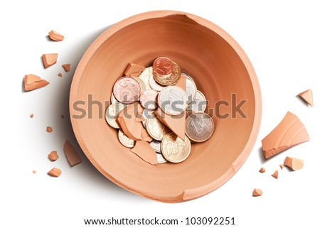 crashed moneybox and coins view from above - stock photo