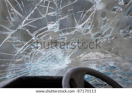 Crashed windshield seen from inside the vehicle - stock photo
