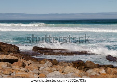 Crashing waves on a rocky South African coast - stock photo