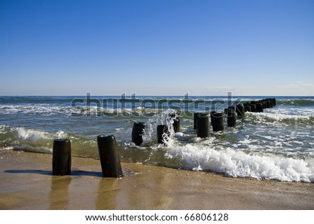 Crashing Waves on an Abandoned Pier - stock photo