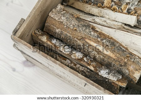 Crate of firewood - stock photo