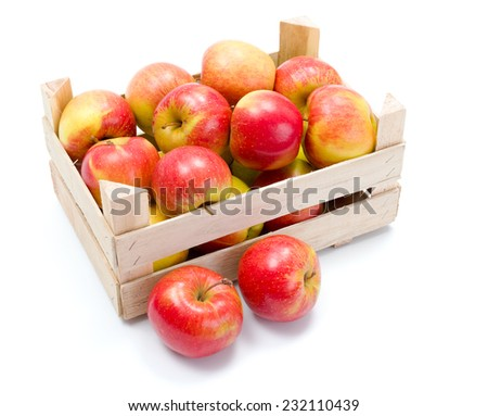 Crate of fresh ripe red apples - stock photo