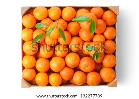 Crate of ripe tangerines. Top view. Isolated on a white. - stock photo