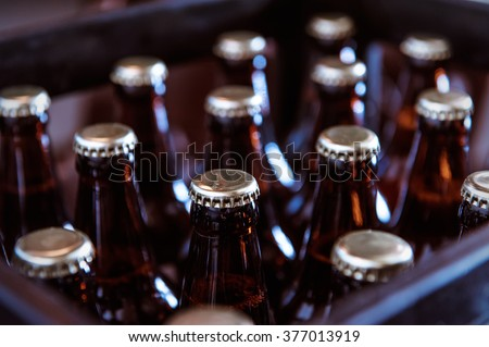 Crate with full beer bottles - stock photo