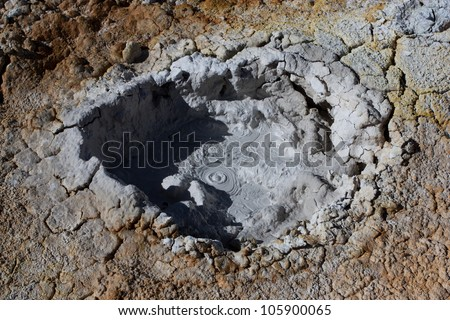 Crater of a geyser at the altitude of 4900 m, in the Eduardo Avaroa Andean Fauna National Reserve in Bolivia - stock photo