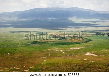 Crater of Ngorongoro. A view on a crater Ngoro Ngoro  in a sunny day from height of the bird's flight. - stock photo