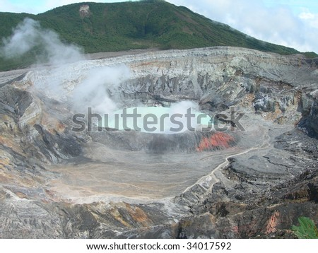 Crater of Poas Volcano with misty sulfur clouds, in national park Costa Rica - stock photo
