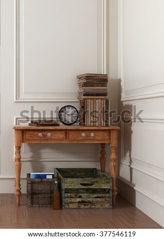 Crates and Baskets Underneath Old Wooden Table Topped with Antique Books and Clock in Modern Room with White Walls and Stylish Paneling. 3d Rendering. - stock photo