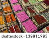 Crates with colorful flowers and plants on a Dutch flower auction - stock photo