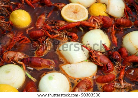 Crawfish being boiled with lemons and onions. - stock photo