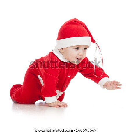 crawling baby boy in Santa clothes - stock photo