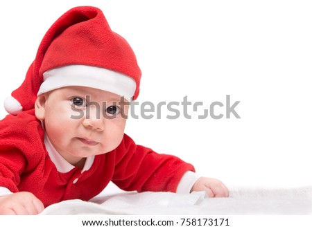crawling baby girl in st claus costume, copy space