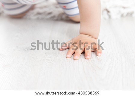 crawling baby hand - stock photo