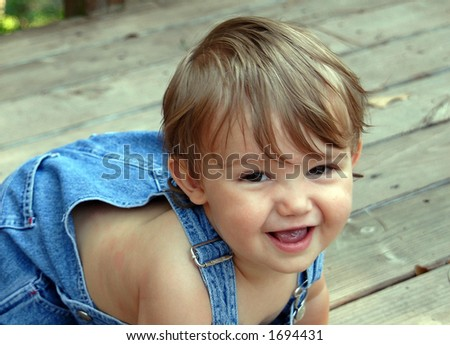 crawling with blue overalls - stock photo