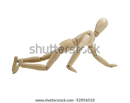 Crawling wood puppet isolated over white background