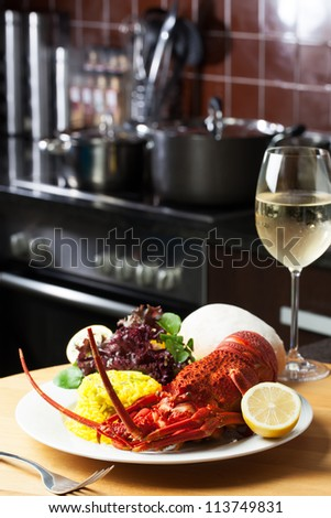 Crayfish on a table served with wine. - stock photo