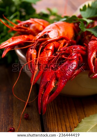 Crayfish on a wooden table - stock photo
