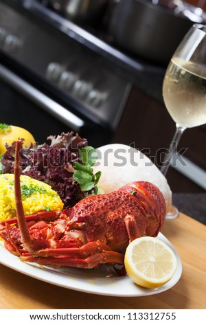 Crayfish served with rise, lettuce and a good glass of wine.. - stock photo