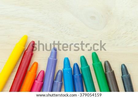 Crayon on wood background - stock photo