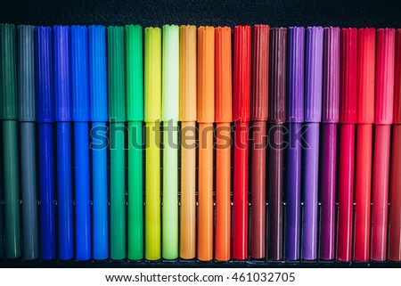 Crayon pens on black background