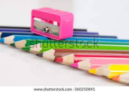 crayon with sharpener for children on whiteboard