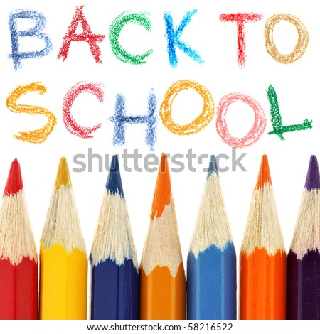 Crayons and back to school text over white background - stock photo
