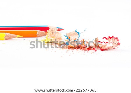Crayons. Colored Pencils. Colored pencils on white background and wood chips - stock photo