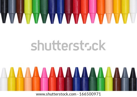 Crayons for children forming a frame, isolated on a white background - stock photo