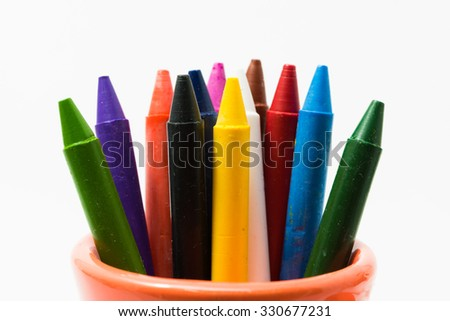 crayons full color close up with small cup