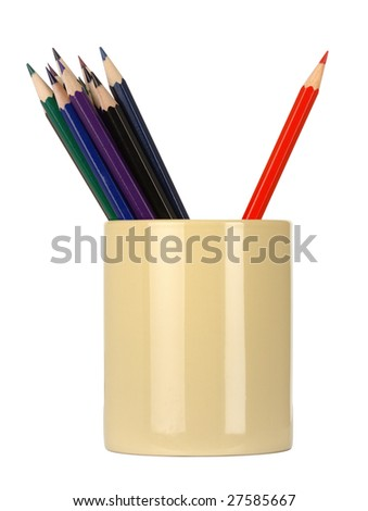 Crayons in a cup, red one is leaned agings the others, standing out of the crowd concept, isolated over white - stock photo