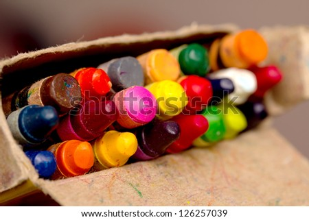 crayons in a pack, the focus in the middle - stock photo