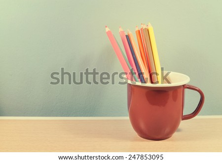 crayons in brown cup vintage concept - stock photo