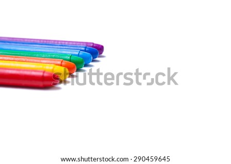 Crayons lined up in rainbow  - stock photo