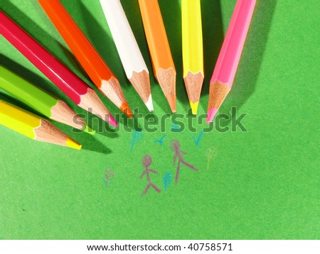 crayons on a green background - stock photo