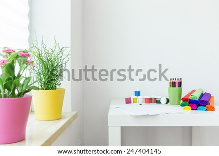 Crayons on a table in child room - stock photo