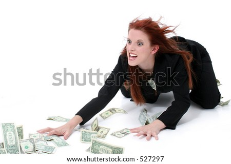 Crazed Business Woman Grabbing Money From Floor.  Very funny expression on model's face. Shot in studio over white. - stock photo